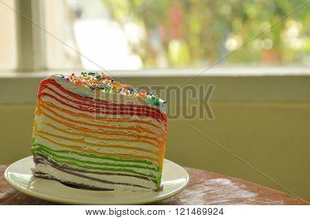 crape cake on dish near window