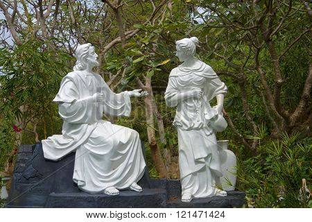 VUNG TAU, VIETNAM - DECEMBER 22, 2015: Mary Magdalene and Jesus Christ. The sculpture on the mountain Nyo, Vung Tau, Vietnam