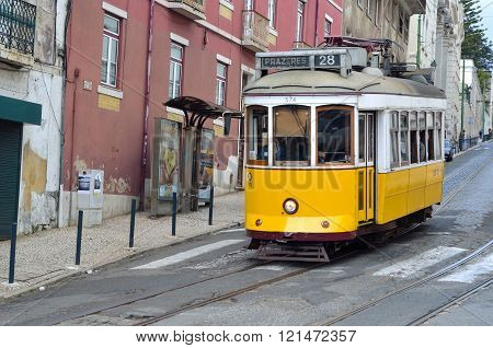 Vintage Tram on the streets of Alfama Lisbon Portugal.