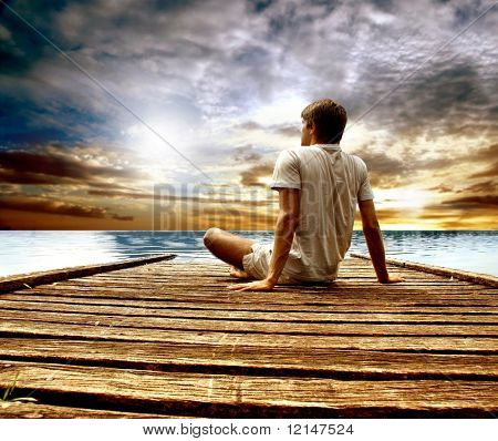 a young man on a wharf
