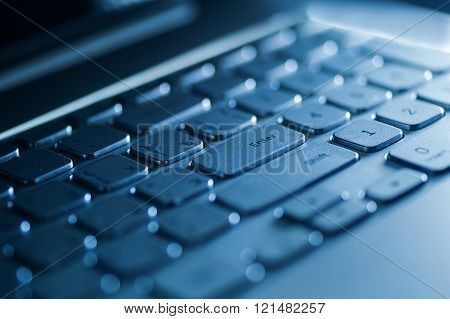 keyboard on a laptop in blue color