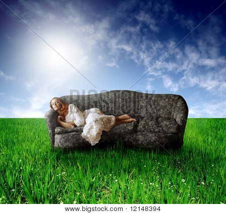 a woman on sofa in countryside