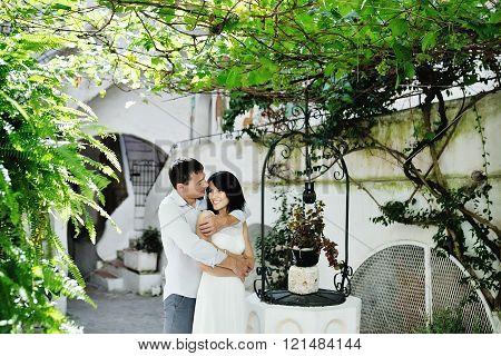Happy Couple Bride And Groom Tenderly Embraced In Wedding Day In Sperlonga, Lazio, Italy
