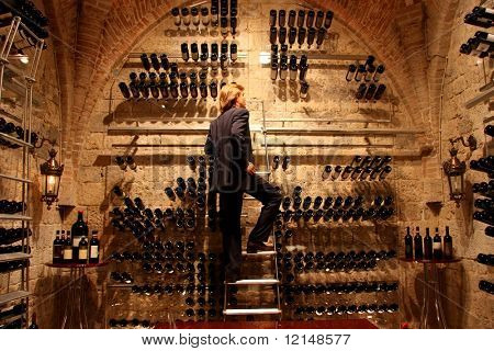 a man in a wine cellar