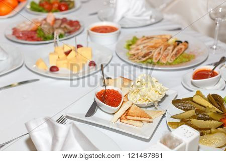 Pickles, Salad, Caviar And Dishes On Holiday Table