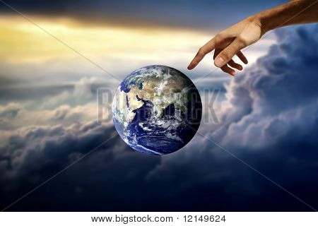 planet earth and a hand