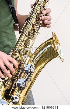 saxophone in the hands of street musician