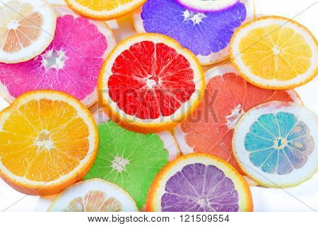 The Multi-colored Citrus Of Artificial Color Cut By Circles Lies On A Table