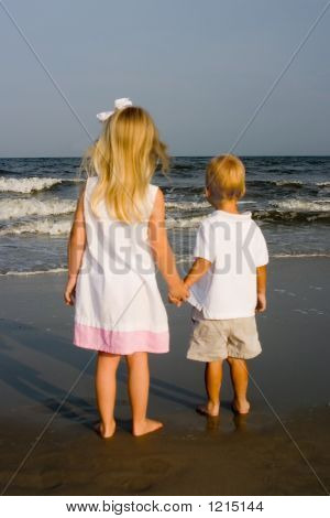 Girl And Boy Holding Hands At The Beach
