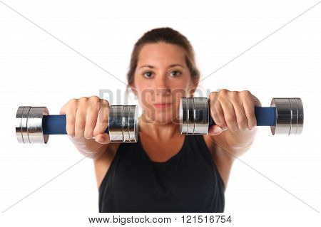 Young woman exercising with dumbbells.