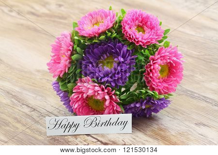 Happy Birthday card with colorful aster flowers bouquet