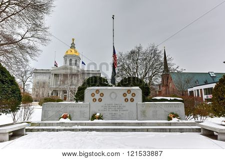 Concord, New Hampshire - February 16, 2016: Concord New Hampshire War Memorial in front of the New Hampshire State House.