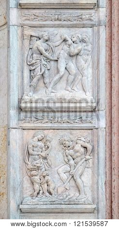 BOLOGNA, ITALY - JUNE 04: Expulsion from Paradise up, the work of Adam and Eve down, panel by Jacopo della Quercia on the central door of San Petronio Basilica in Bologna, Italy, on June 04, 2015