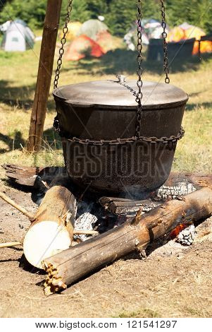 Cooking In A Large Pot On The Fire.