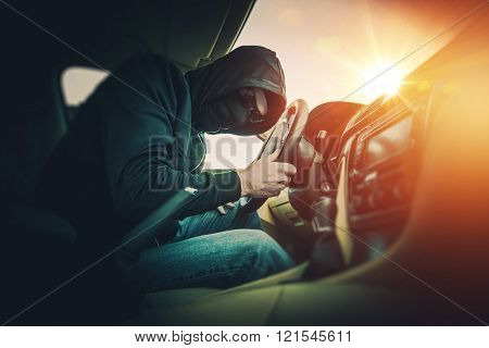 Car Thief In Mask And Glasses