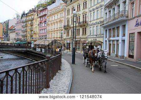 Karlovy Vary, Czech Republic - April 27, 2013: Horse Carriage On The Street Of Karlovy Vary Or Carls