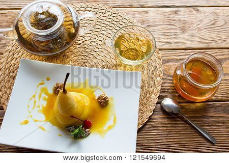 Pear in orange juice with herbal tea
