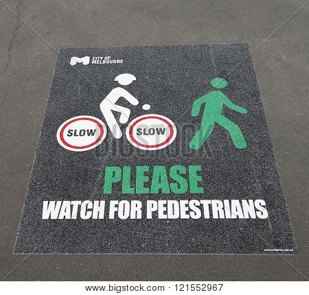 Sign Watch for pedestrians at bicycle path in Melbourne