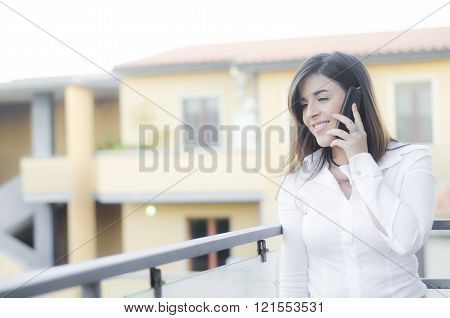 Caucasian beautiful girl smiling on the phone outdoor
