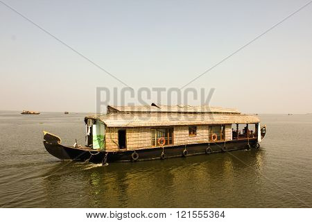 Sailing boat at sunset in the back waters