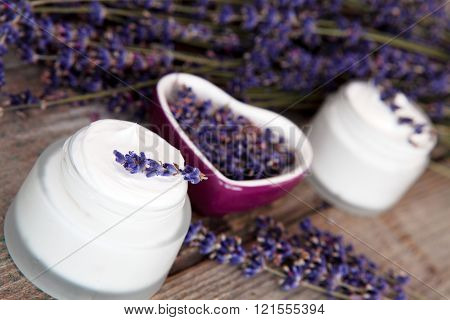 lavender flowers and anoint lying on old garden table ** Note: Soft Focus at 100%, best at smaller sizes