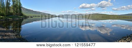 Panorama. Lake in the Putorana plateau. Summer water landscape in Taimyr.