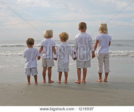 Children Holding Hands At The Beach