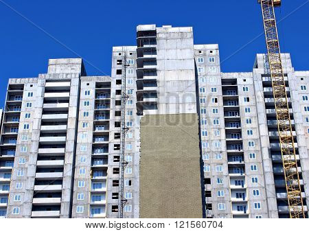Installation of thermal insulation plates of mineral wool of a facade of monolithic reinforced concrete multistory building