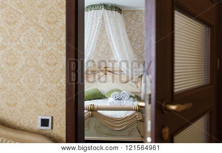 Half open door of a hotel bedroom