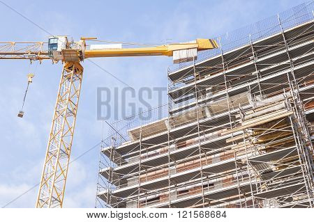 Building Under Construction With Building Armor And A Crane.