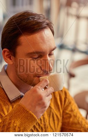 Content man drinking coffee
