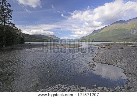 Small Creek Emptying Into An Alpine Lake