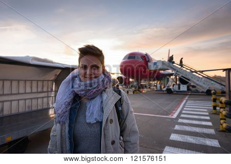 Young woman and airplane