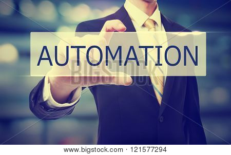 Business Man Holding Automation Concept