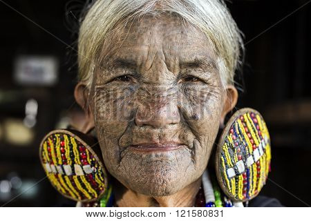 Chin Tribe tattooed faced woman (Daai)