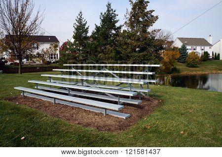 Seats Beside a Baseball Field