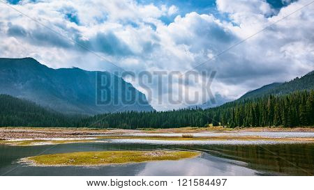 Mountain Valley Waterway. Hyalite Reservoir, Montana, USA. Landscape Background with Copy Space.