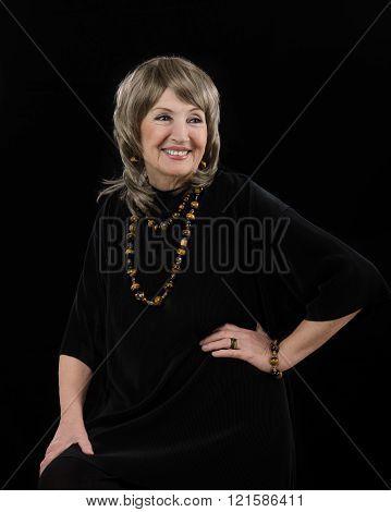 Stunning senior woman with tiger-eye jewelry