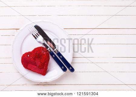 Romantic table setting. Decorative red heart knife and fork