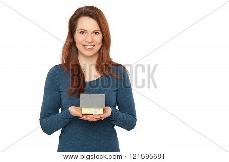 Young smiling woman holding a house in her hands