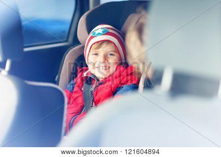 Portrait of preschool kid boy sitting in car