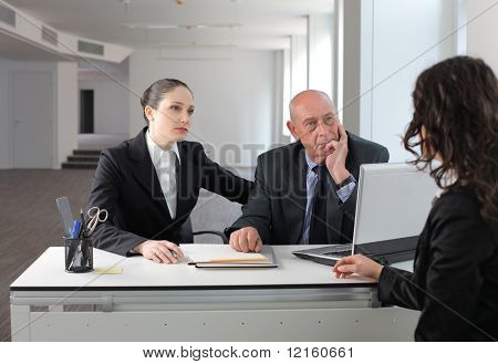 Businesswoman in an interview with two business people
