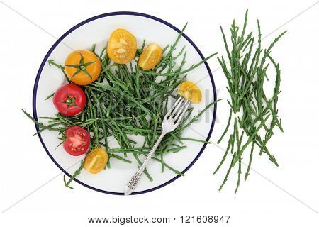 Health food of samphire and tomato vegetables on a plate with silver fork over white background. High in antioxidants. poster