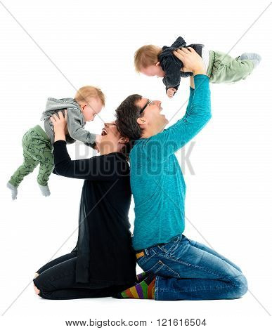 Happy Family With Adopted Twins Is Laughing. Isolated On White.