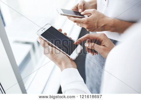 Female is chatting in network on cell telephone