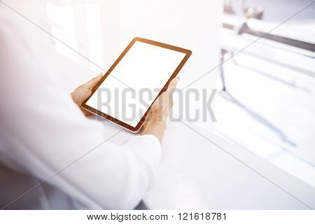 Female is reading information on website via touch pad