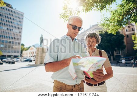 Couple travelling in city with a road map
