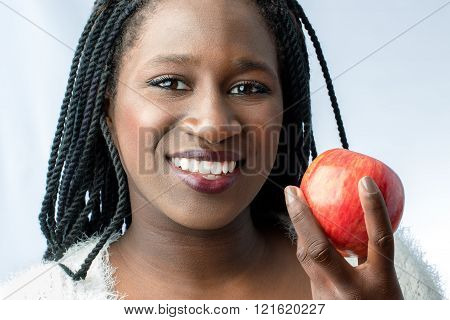Cute African Teen With Charming Smile Holding Red Apple.