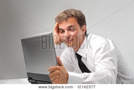 businessman bored with laptop