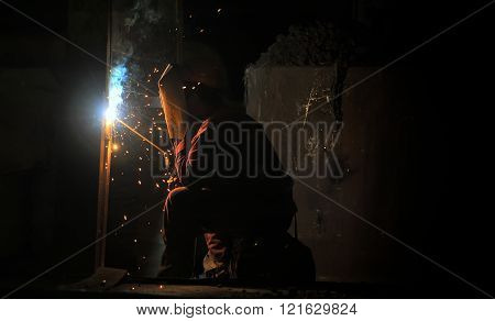 Worker Welding Steel